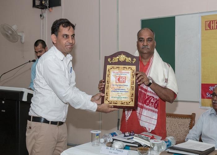 Dr Rajesh kumar Director JPL ICHR felicitating Dr Balmukund Pandey